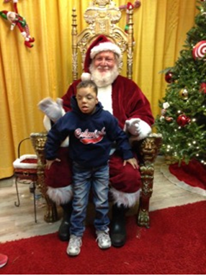Devin stands in front of Santa