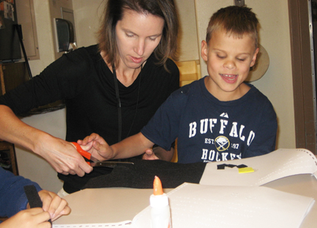 Boy and Teacher Working on Crafts