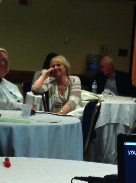 Project Officer JoAnn McCann smiling in group