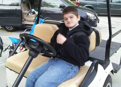 Boy in Golf Cart
