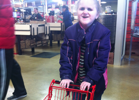 Girl Pushing Shopping Cart