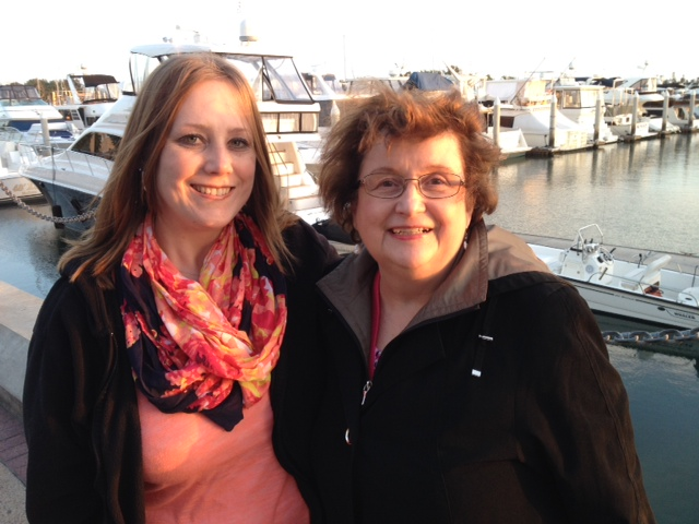 Susan Bruce and Nicole Johnson in front of marina