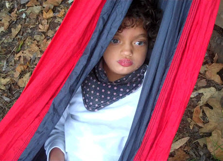 Young girl, Camila, in hammock