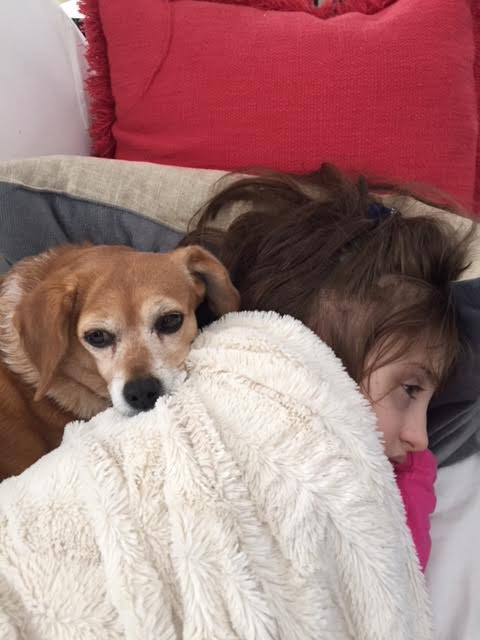 Grace laying down with dog.