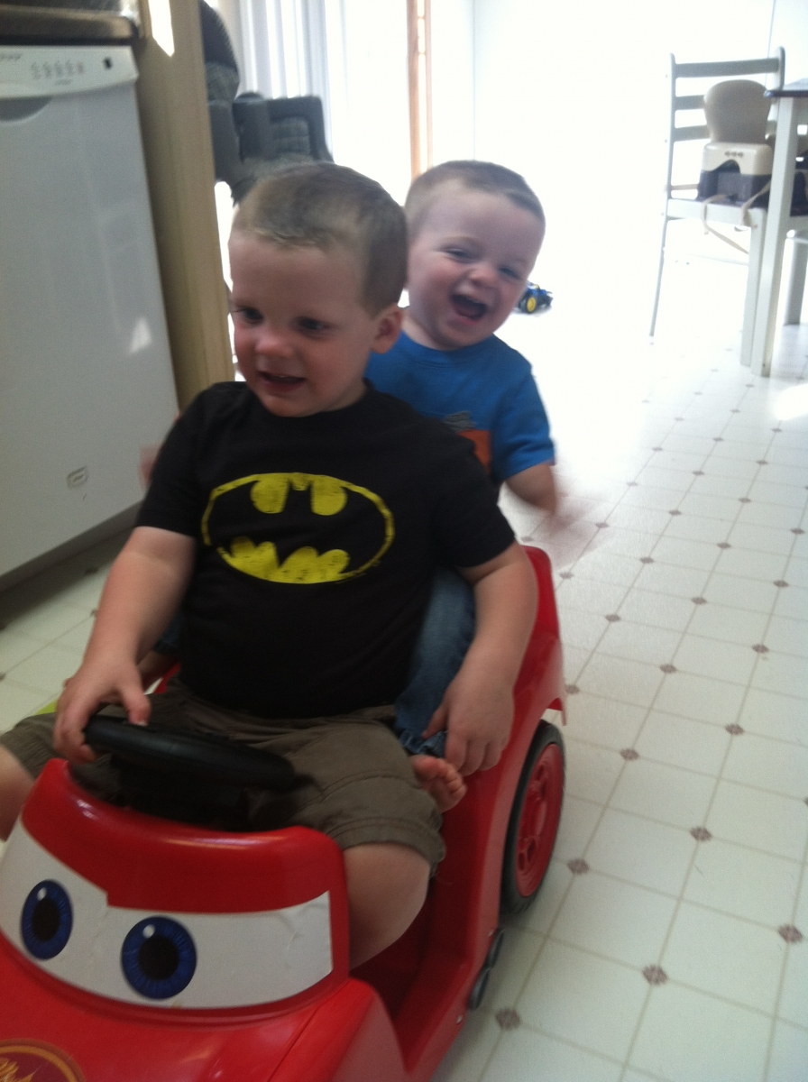 Liam and Finn riding in fire truck