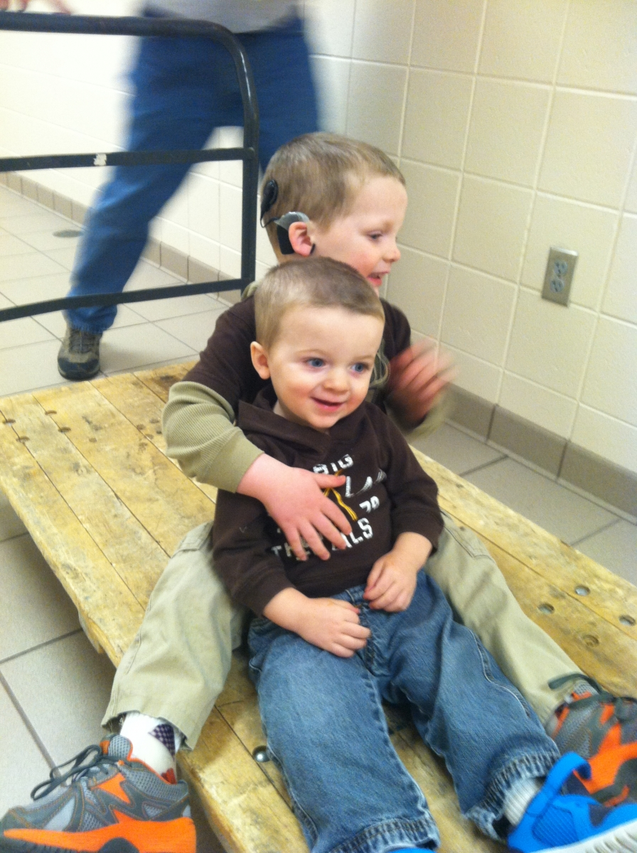 Liam and Finn riding on a dolley