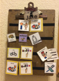 Jake's communication clipboard hangs on the wall