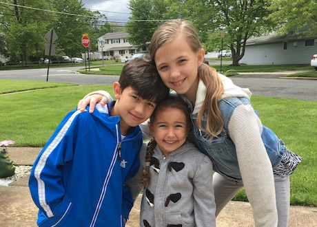 Ava with siblings