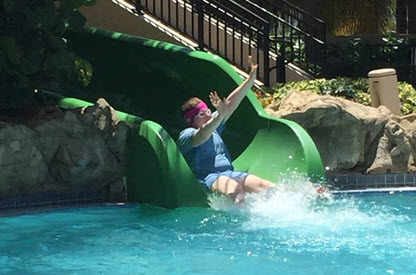 Megan goes down a water slide