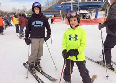 The boys pose on their skis