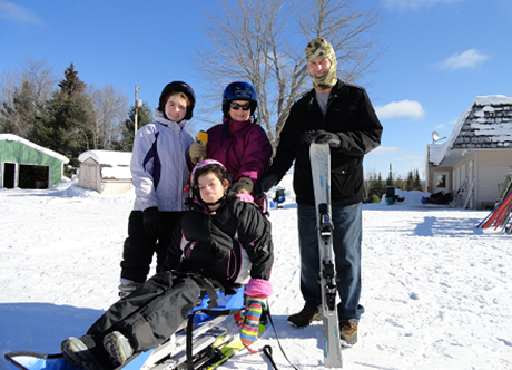 Family photo of skiing vacation