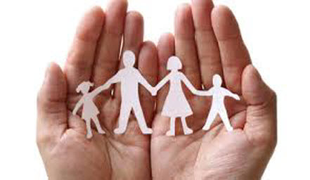 Open hands with a cut out paper family.