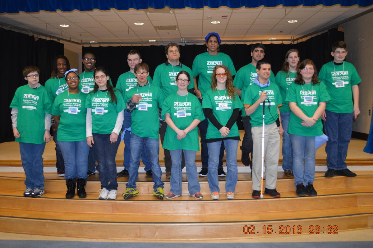 Sixteen young adult participants and mentors standing for a group picture at the regional Institute in South Carolina