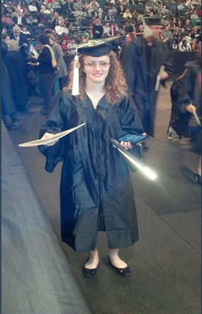 Tiffany in her cap and gown at her college graduation from the University of South Florida.