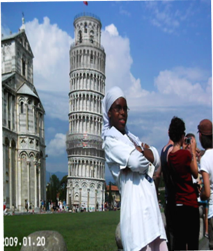 Zaakirah taking a picture next to the Leaning Tower of Pisa in Italy.