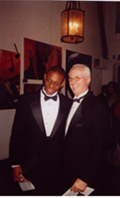 Winfield posing with a friend at one of his art events.