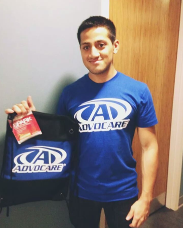 Eddie poses for a picture with some AdvoCare merchandise.
