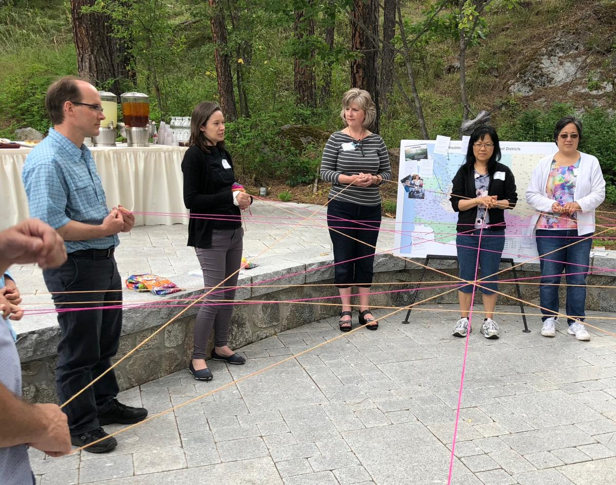 Group holding yarn that is connected in a web.